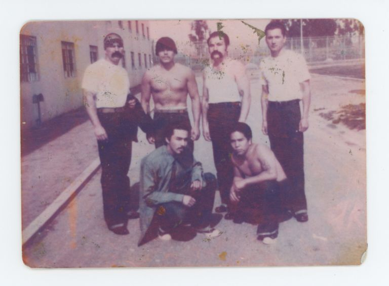 Color Snapshot of 6 Men in a Prison Yard. Anonymous.